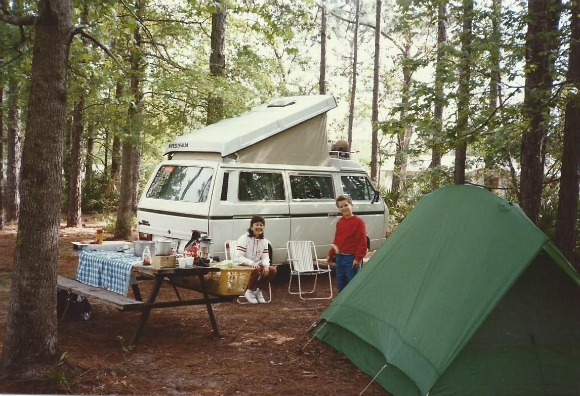 Camper, tent, woman and boy enjoying a Florida State Park